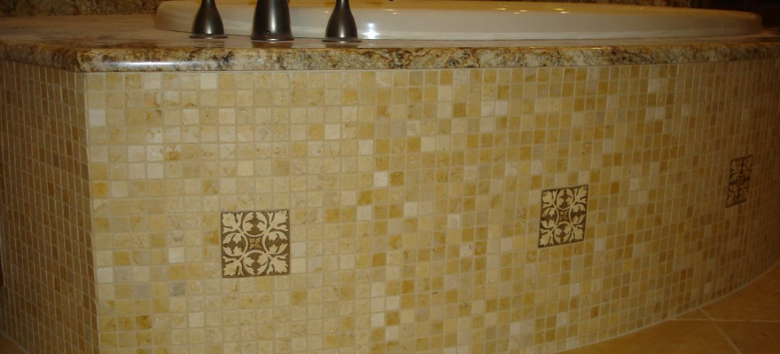 Deco-tile-on-tub-face,-mosaic-tile-master-bathroom,-tucson